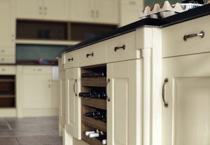 ivory kitchen and wine rack with cupboard doors and handles