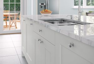 porcelain kitchen island in white with sink and fruit bowl