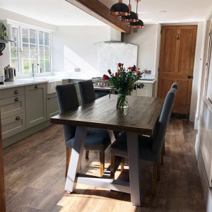 new kitchen, gorgeous flowers on the table, vintage lighting, wooden flooring, wooden table