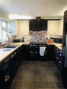 kitchen after the cook and sleep transformation, deep heather and mussle units, oak worktop and granite composite sink