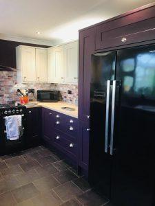 Deep heather base and larder units inside new kitchen