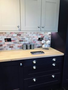 upclose shot of worktop and the mussel wall units