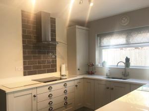 cook sleep, kitchen stori, kitchen renovation, kitchen transformation, new kitchen, boiler cupboard, warm lighting