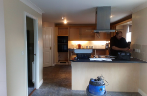 before the renovation, cupboards at the back in the process of being taken out