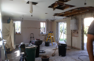 before the renovation, empty room with structural changes being made